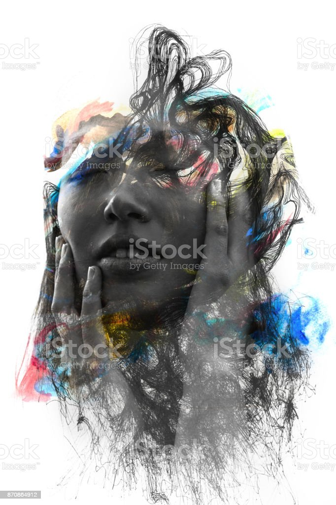Paintography. Portrait of an attractive young woman combined with hand drawn paintings with a dissolving effect stock photo