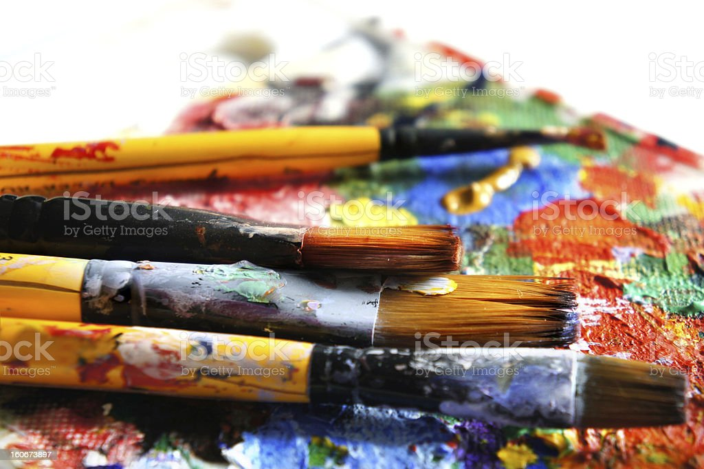 Paints and paintbrushes stock photo
