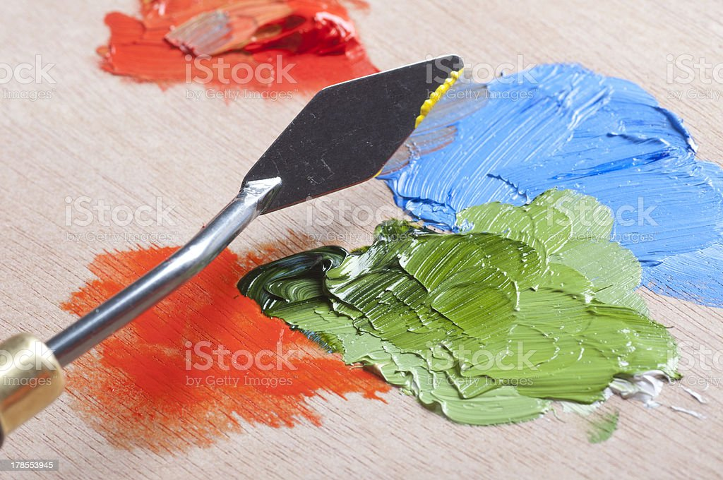 Paints and palette knife stock photo