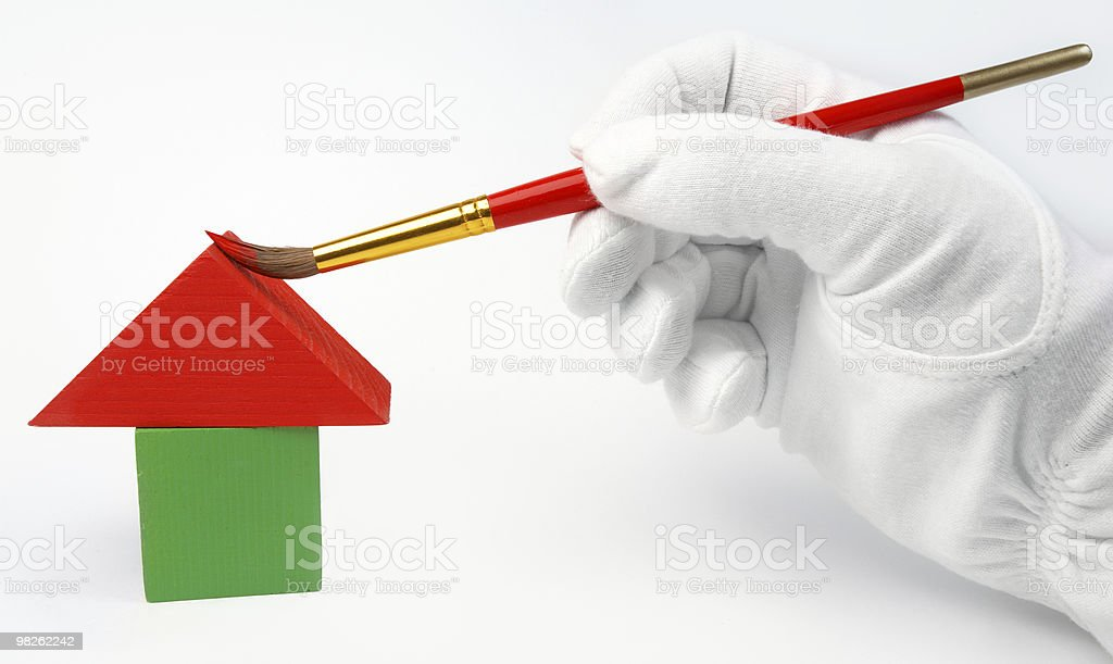 Paints with brush small house royalty-free stock photo