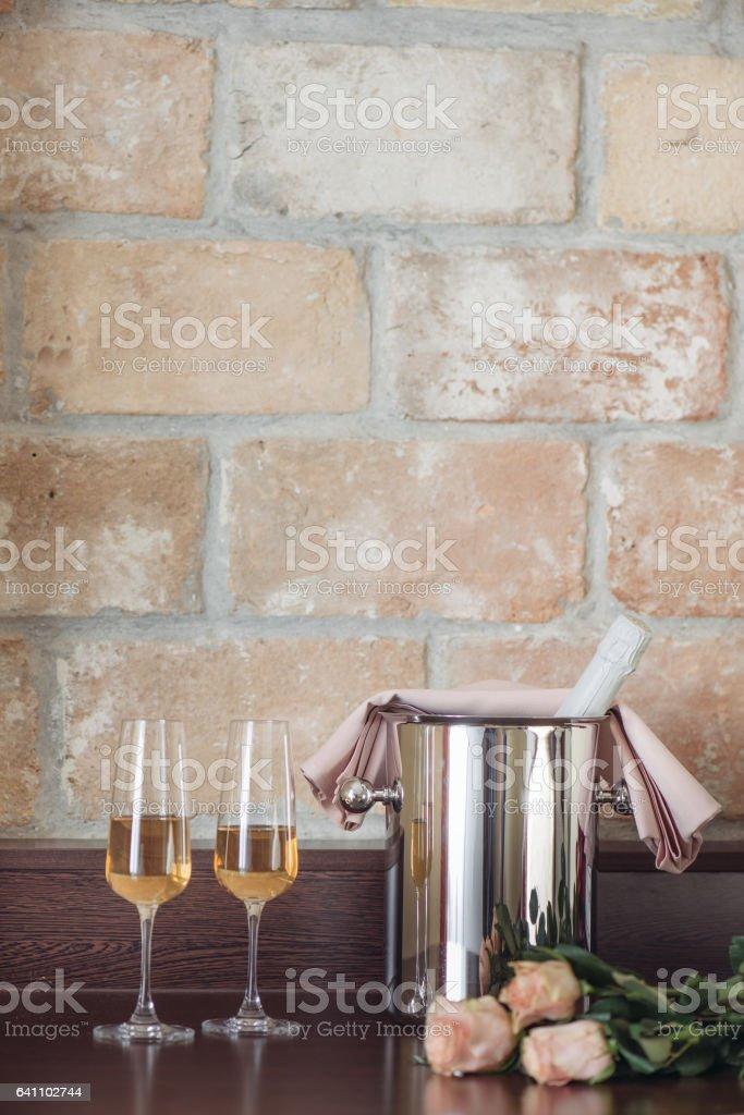 Pair glass of champagne with bottle in metal container. Elegant hotel room interior. stock photo
