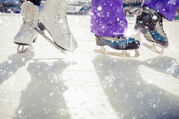 Pair is placed on ice skating. It is snowing outside stock photo