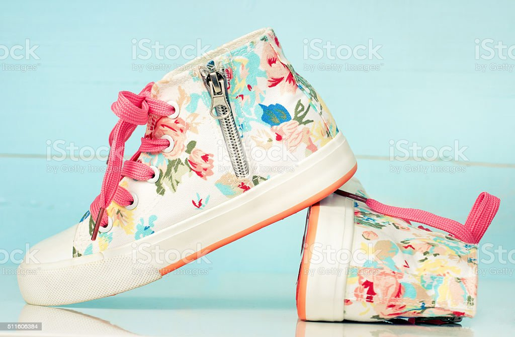 Pair kid's girl's textile sneakers vintage retro shoes. stock photo