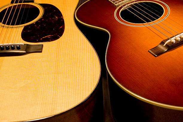 Pair of acoustic guitars stock photo