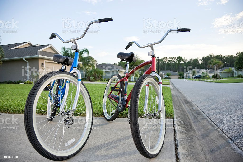 Pair of adult bicycles on driveway stock photo