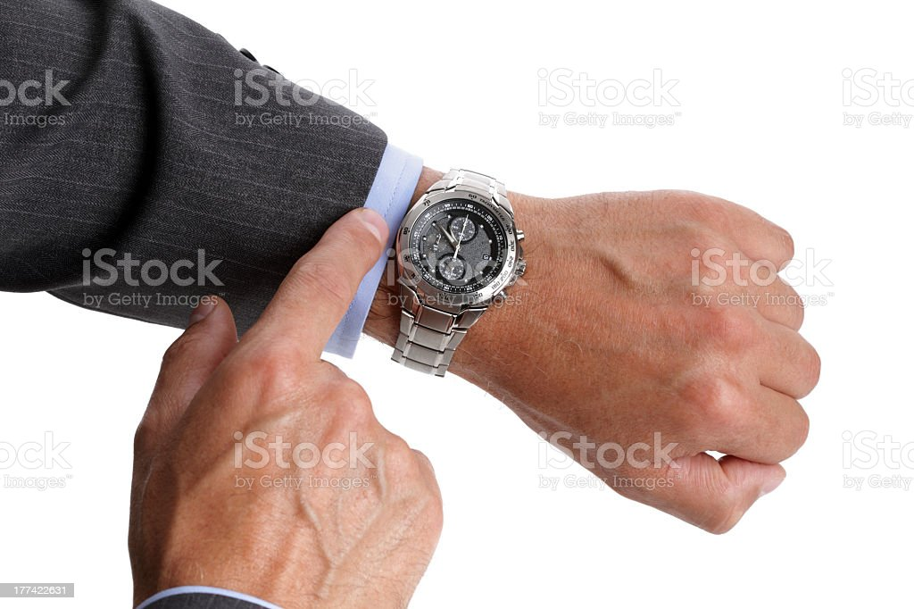 Pair of an older businessman checking the time on his watch royalty-free stock photo