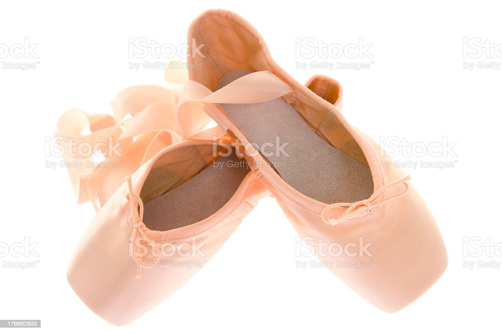 Pair of ballerina pointe shoes on white background stock photo