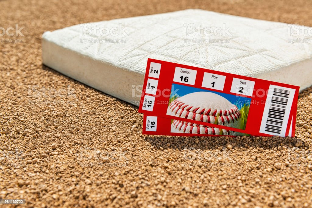 A low angle view of a pair of baseball game ticket stubs next to...