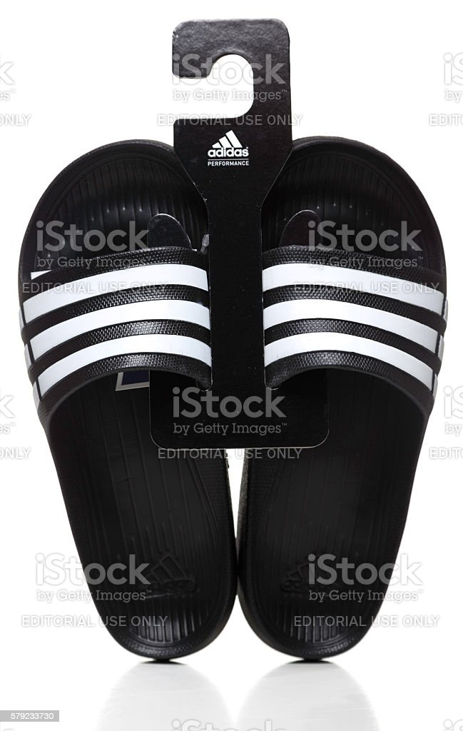 Pair of black Adidas Slide sandals stock photo