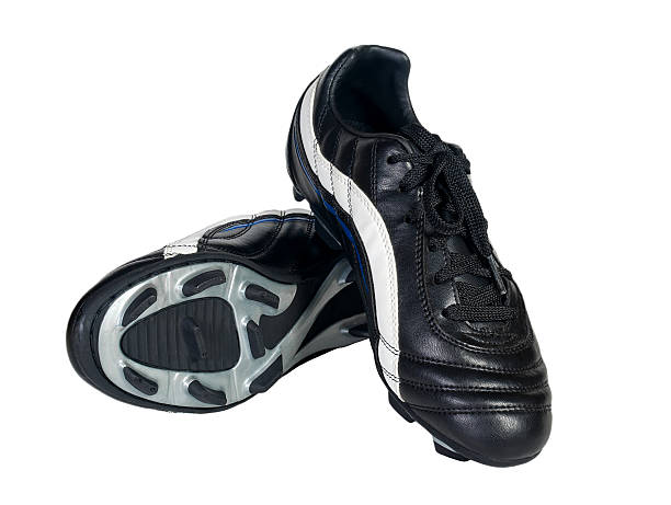 Pair of black athletic shoes on a white background Soccer shoes on a white background studded stock pictures, royalty-free photos & images