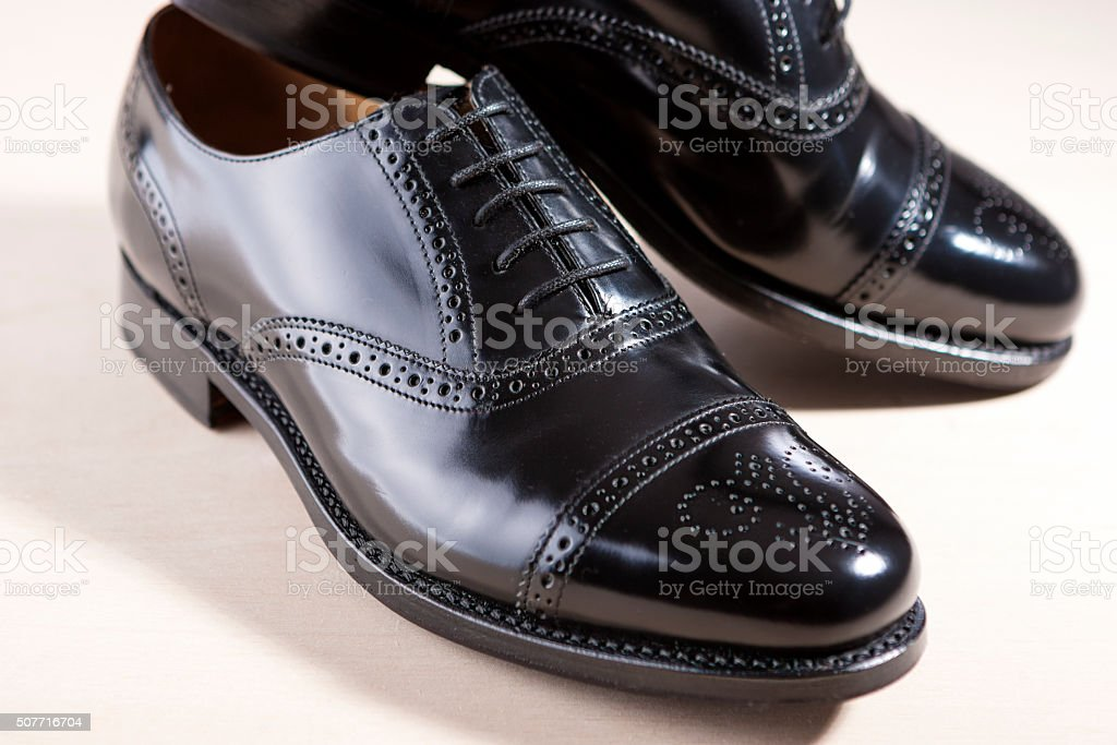 Pair of Black Fashionable Male Oxfords Semi-Brouge Laced Shoes stock photo