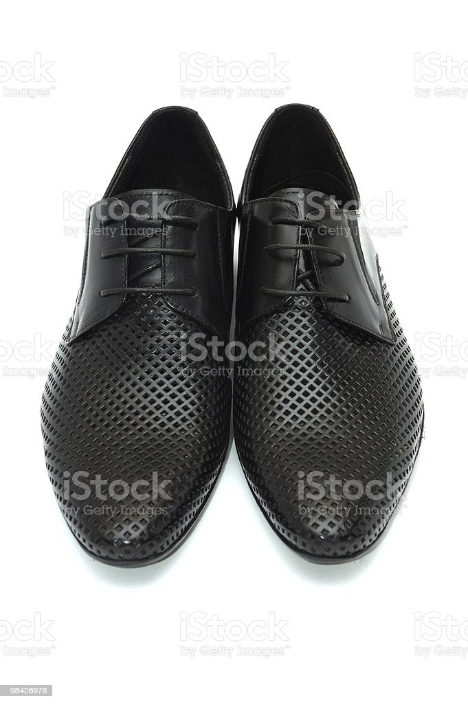 Pair of black leather shoes royalty-free stock photo
