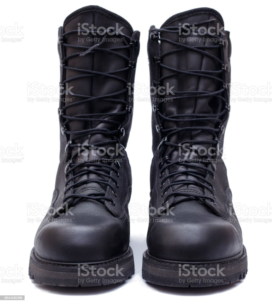 Pair of black military style leather boots, isolated, front view stock photo