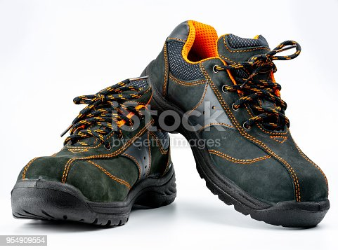 istock Pair of black safety leather shoes isolated on white background with copy space. Work shoes for men in factory or industry to protect foot from accident. Safety footwear. Oil and acid resistant shoes 954909554