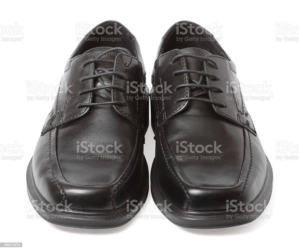 Pair of black shoes isolated on white stock photo