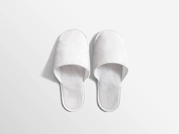 Pair of blank soft white home slippers, design mockup stock photo