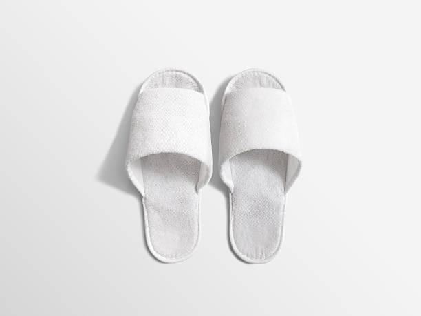 Pair of blank white home slippers, design mockup stock photo