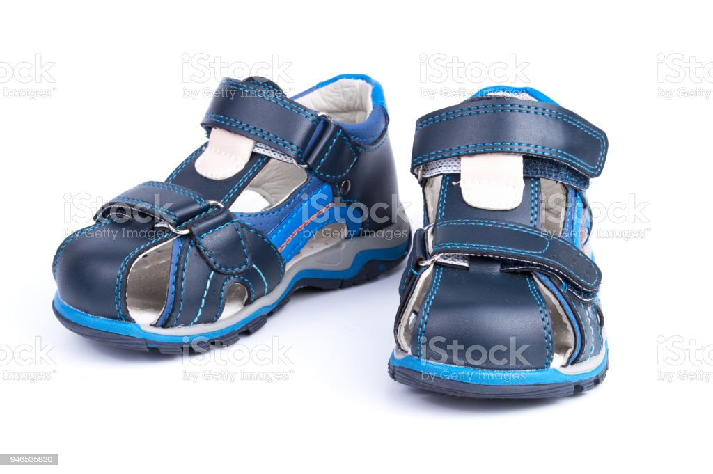 22204eab7450 Pair of blue baby sandals shoes isolated on white background - Stock image .
