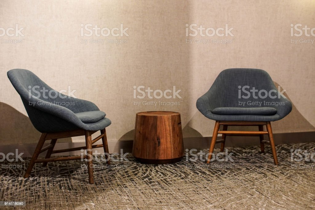 pair of blue mid century modern chairs stock photo