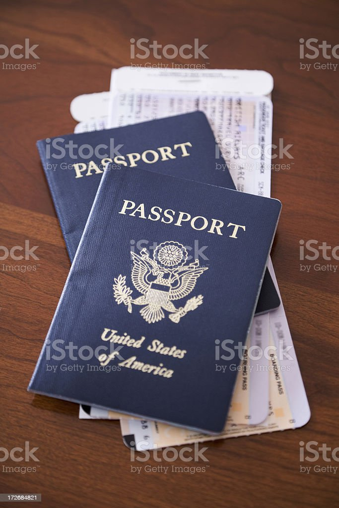 pair of blue USA passports and two 2 airplane tickets royalty-free stock photo