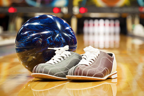 Pair of bowling shoes and ball with blurred line background stock photo