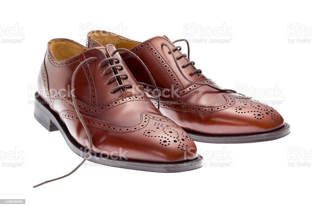 Pair of brown brogues on white stock photo