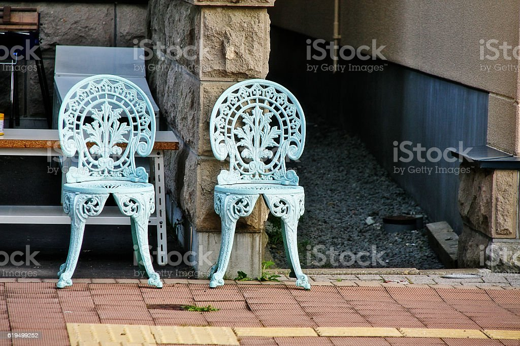 Pair of chairs in front of house stock photo