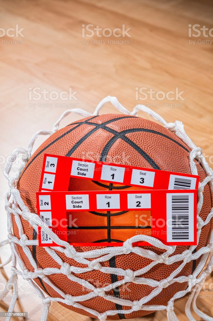 A close-up low angle view of a pair of ticket stubs to courtside...