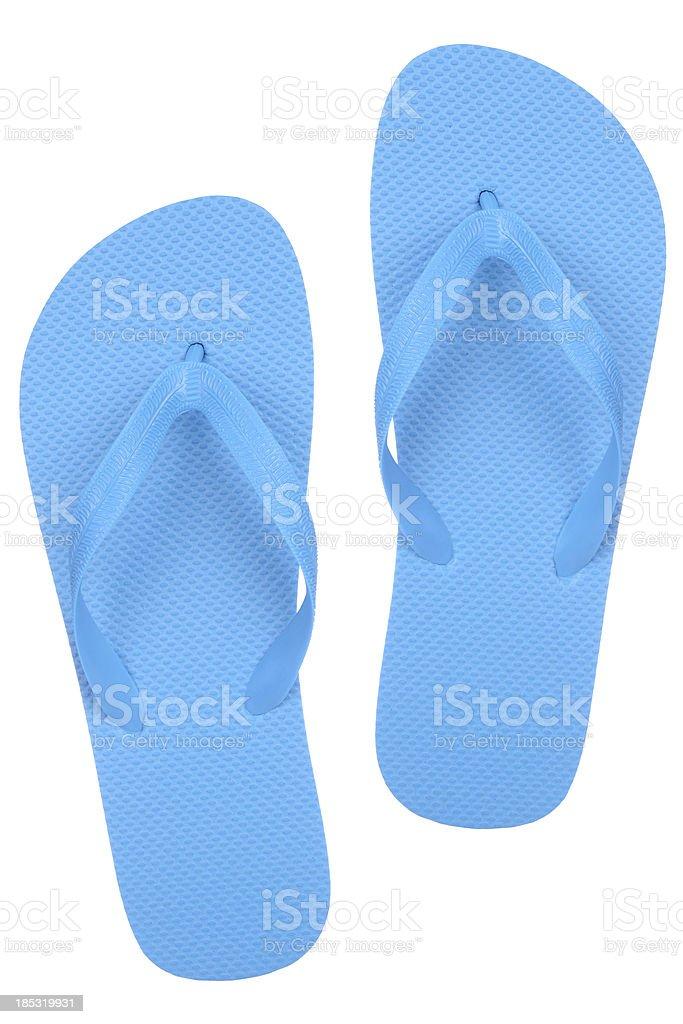 A pair of cheap blue flip flops stock photo