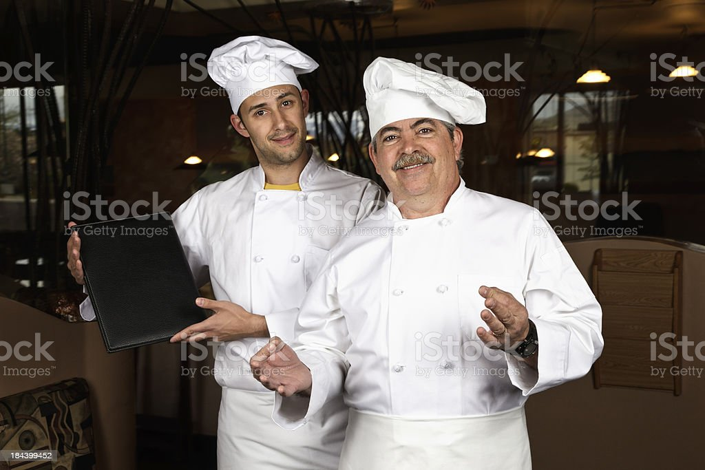 Pair of Chefs Give Welcome in Restaurant royalty-free stock photo