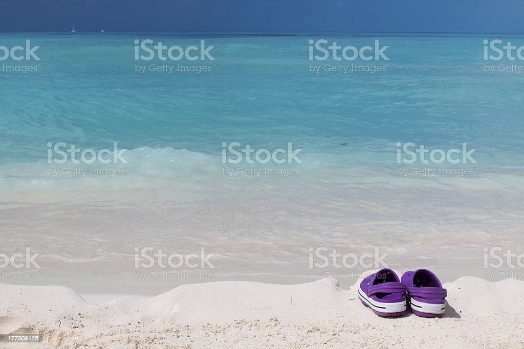 e0a73dd13 Pair Of Colored Sandals On A White Sand Beach Stock Photo   More ...
