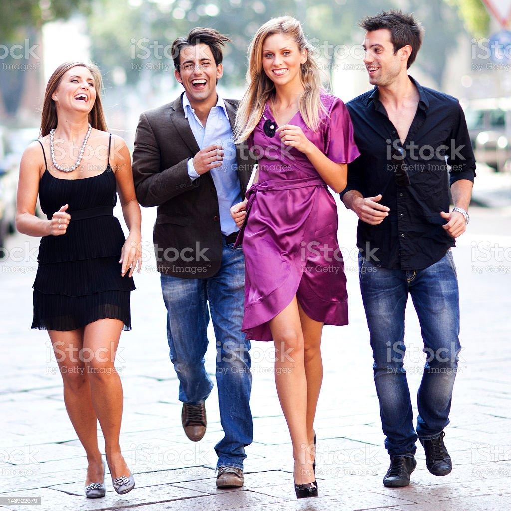 Pair Of Couple Running On Street royalty-free stock photo