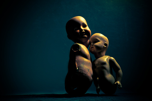 Pair of creepy dolls