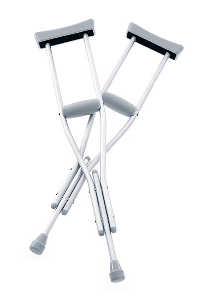 Pair of crutches against white background stock photo
