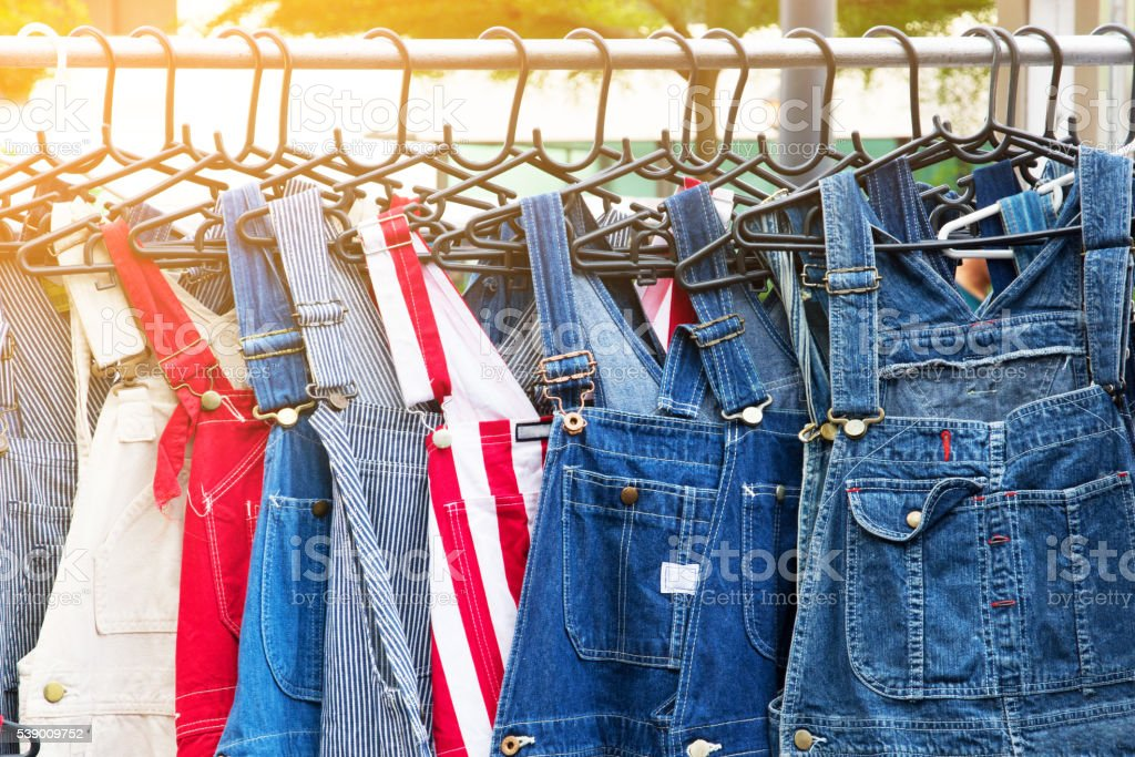 Pair of denim dungarees stock photo