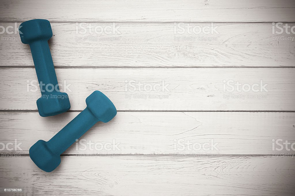 Pair of dumbbells on wooden background stock photo