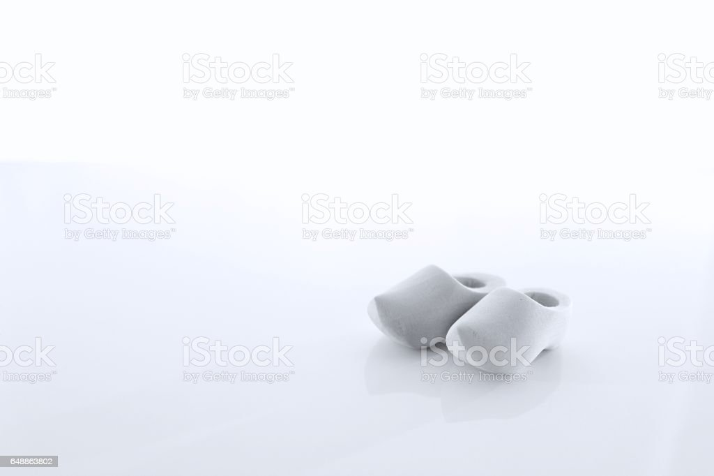 A pair of Dutch wooden shoes from the Netherlands isolated stock photo