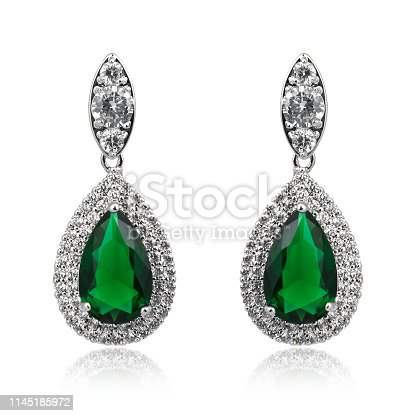 Pair of emerald earrings isolated on white background