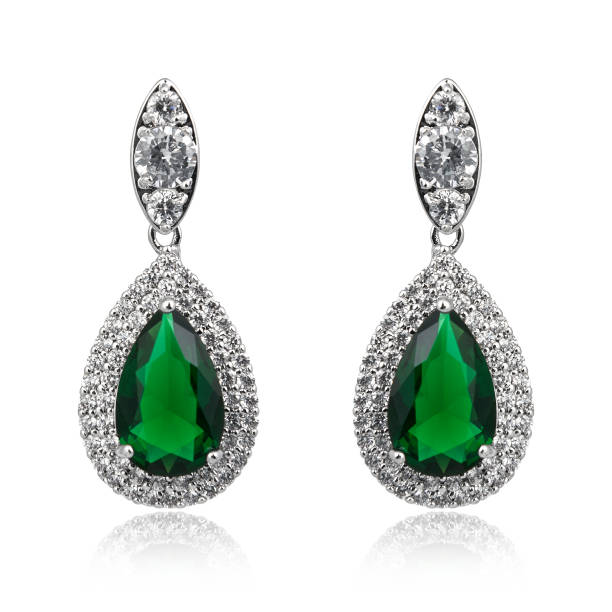 Pair of emerald earrings isolated on white background Pair of emerald earrings isolated on white background amulet stock pictures, royalty-free photos & images