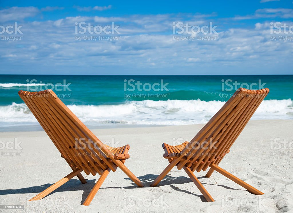pair of empty wooden chairs a beach in Florida, USA royalty-free stock photo