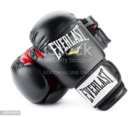 Ankara, Turkey - November 25, 2014: Everlast is an American brand manufacturing, licensing and marketing of boxing and fitness related sporting goods equipment, clothing, footwear, and accessories. Based in Manhattan, Everlast's products are sold in more than 75 countries.  A pair of black Everlast gloves isolated on white background.