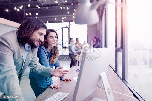 istock Pair of fashion designers discussing ideas in design studio environment 637948674