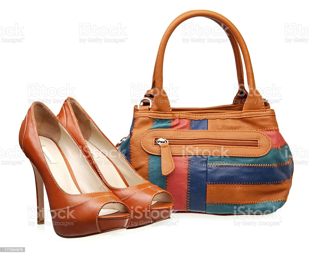 Pair of fashion women shoes and handbag over white stock photo