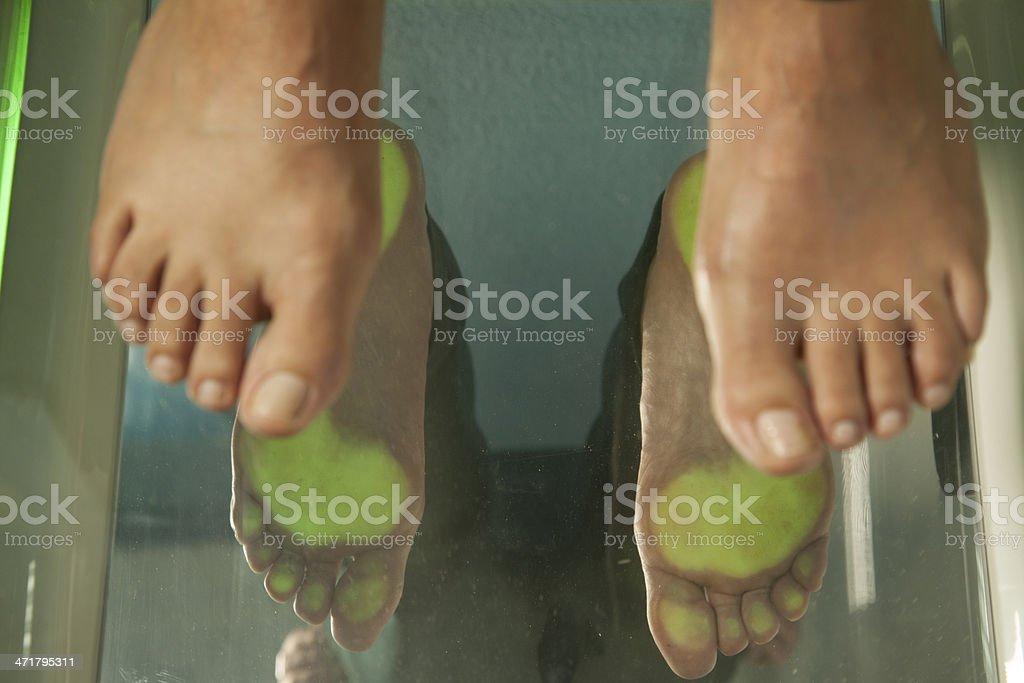 A pair of feet at a podiatrist checkup stock photo