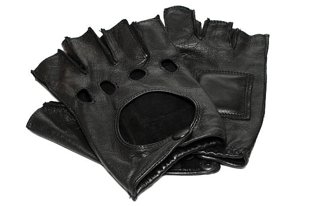 pair of fingerless black leather gloves - sports glove stock photos and pictures