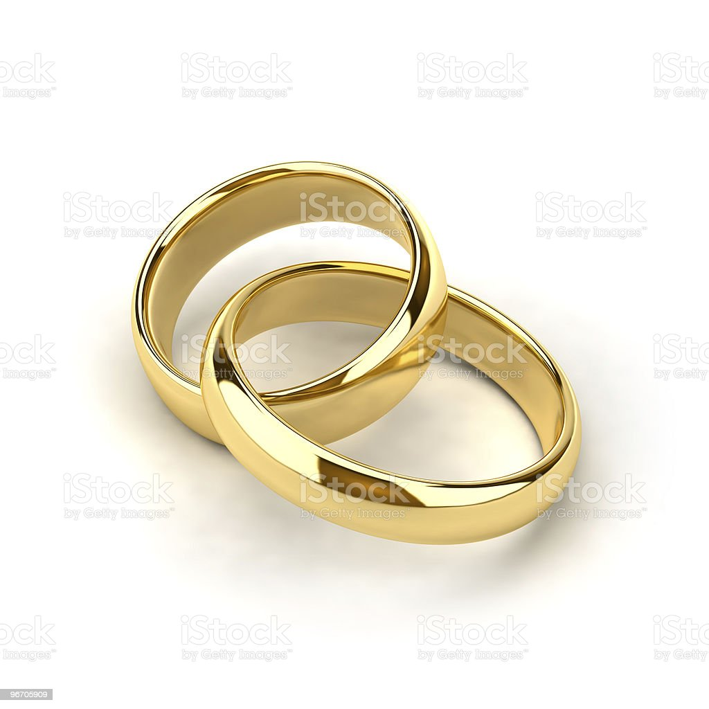 A pair of gold wedding rings entwined stock photo