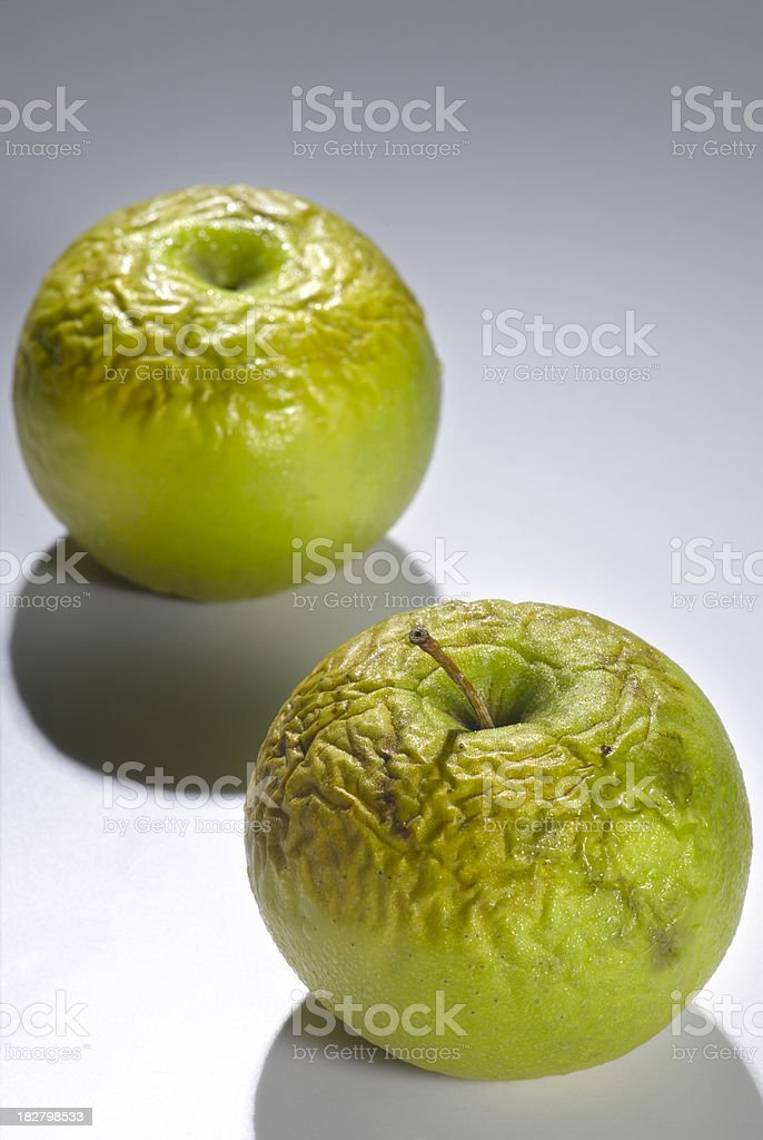 Pair of half rotten green apple royalty-free stock photo