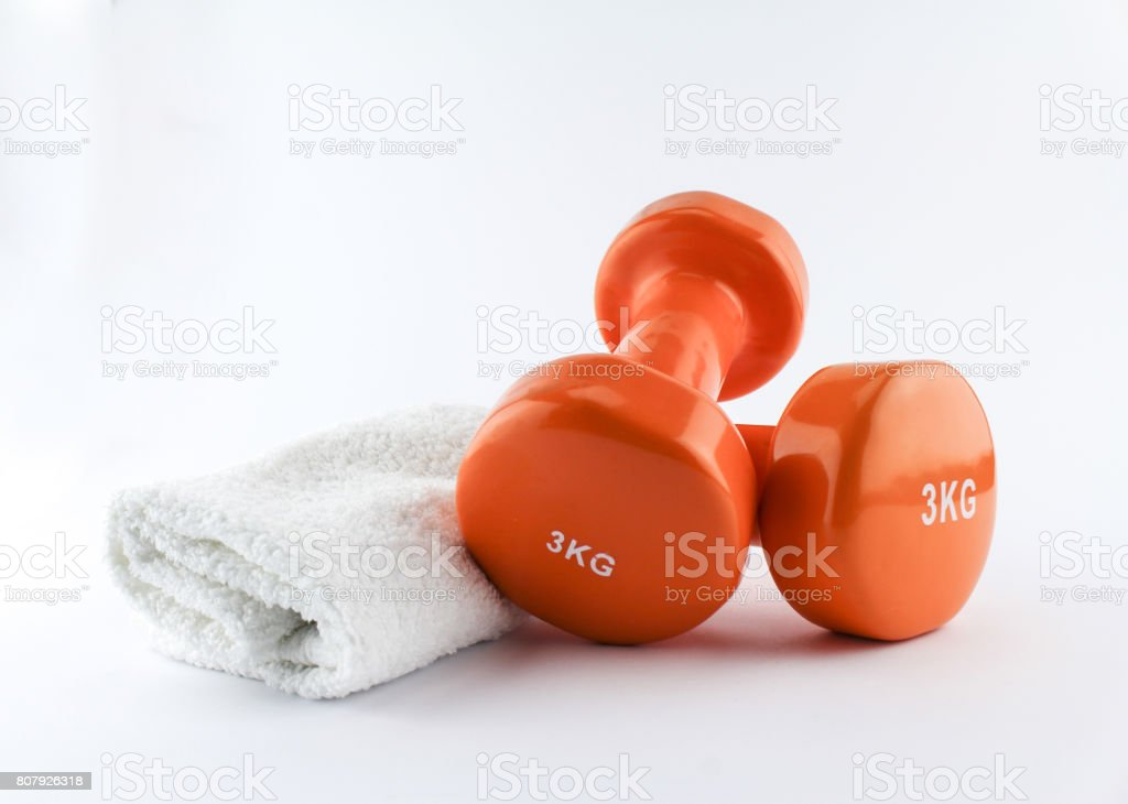 A pair of hand weights and towel. Isolated on white, clipping path stock photo