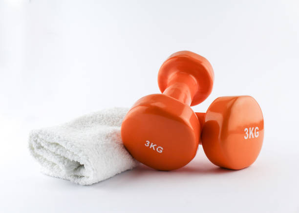 a pair of hand weights and towel. isolated on white, clipping path - dumbbell stock pictures, royalty-free photos & images