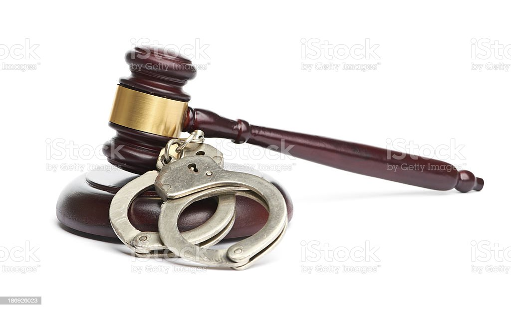 pair of handcuffs and gavel royalty-free stock photo